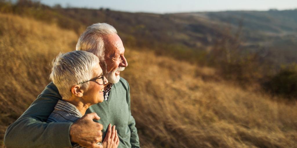 Senior couple overlooking field